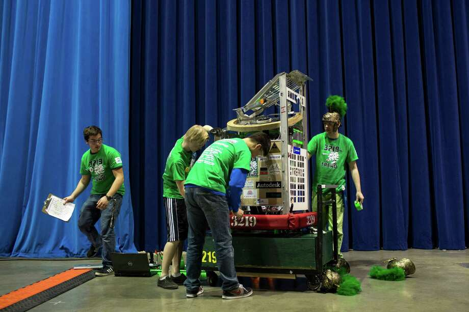Auburn High School students make last-minute preparations to their robot backstage. Photo: JORDAN STEAD / SEATTLEPI.COM