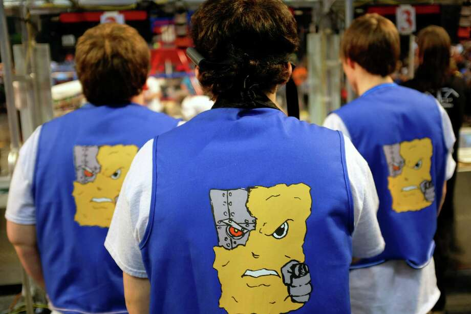 A team shows off their signature vest design during the qualifying rounds. Photo: JORDAN STEAD / SEATTLEPI.COM