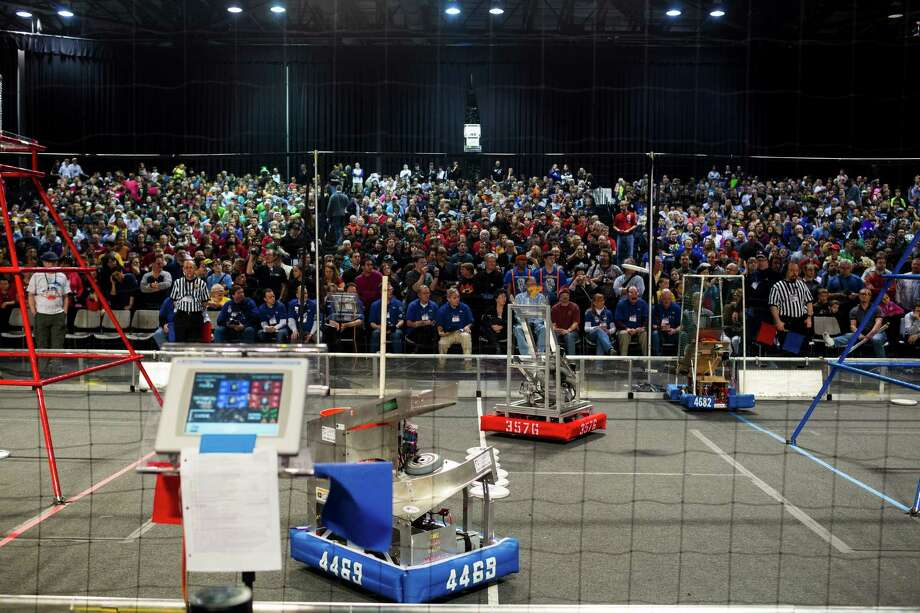Robots whip around the ring during the qualifying rounds. Photo: JORDAN STEAD / SEATTLEPI.COM
