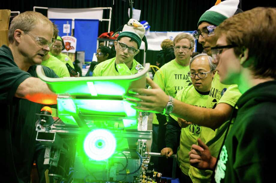 From the safety of the pits, a team shows off the features of their custom robot. Photo: JORDAN STEAD / SEATTLEPI.COM
