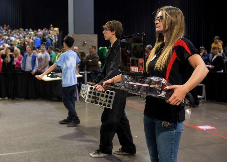 Competitors prepare to take the stands with their robot control units. Photo: JORDAN STEAD / SEATTLEPI.COM