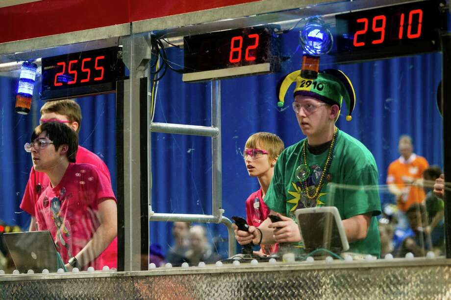 From their control panels, students work to guide their robots toward the opposing goal. Photo: JORDAN STEAD / SEATTLEPI.COM