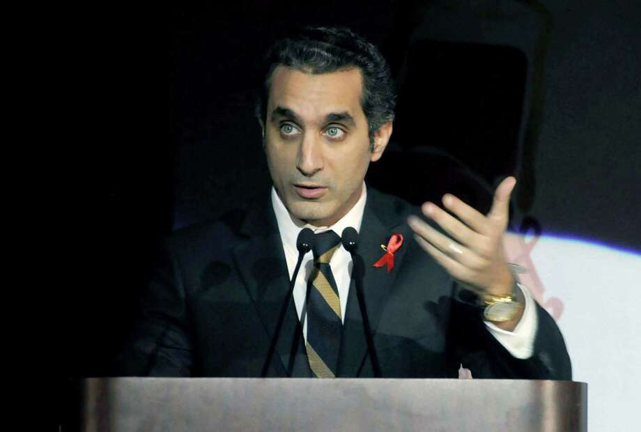 FILE - In this Saturday Dec. 8, 2012 file photo, Egyptian TV host Bassem Youssef addresses attendants at a gala dinner party in Cairo, Egypt. Egypt's state news agency said Saturday, March 30, 2013 that the public prosecution office has issued an arrest warrant against a popular TV satirist for allegedly insulting Islam and the country's president. The warrant issued Saturday is the latest in a series of legal action against Youssef, known as Egypt's Jon Stewart. The warrant comes amid a widening crackdown against opposition figures, driving fears over freedoms of expression and assembly. (AP Photo/Ahmed Omar, File) Photo: Ahmed Omar