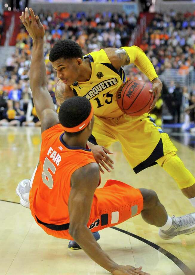 Marquette guard Vander Blue (13) knocks Syracuse forward C.J. Fair (5) to the floor in the first half of the NCAA Tournament East Regional final at the Verizon Center in Washington, D.C., Saturday, March 30, 2013. (Mark Gail/MCT) Photo: Mark Gail, McClatchy-Tribune News Service / MCT
