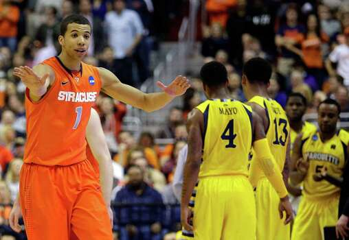 WASHINGTON, DC - MARCH 30:  Michael Carter-Williams #1 of the Syracuse Orange reacts after a call against the Marquette Golden Eagles during the East Regional Round Final of the 2013 NCAA Men's Basketball Tournament at Verizon Center on March 30, 2013 in Washington, DC. Photo: Rob Carr, Getty Images / 2013 Getty Images