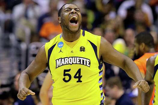 Marquette forward Davante Gardner (54) reacts after scoring during the first half of the East Regional final in the NCAA men's college basketball tournament against Syracuse, Saturday, March 30, 2013, in Washington. (AP Photo/Alex Brandon) Photo: Alex Brandon, Associated Press / AP