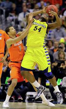Marquette forward Davante Gardner (54) loses control of the ball under pressure from Syracuse guard Michael Carter-Williams (1) during the first half of the East Regional final in the NCAA men's college basketball tournament, Saturday, March 30, 2013, in Washington. (AP Photo/Alex Brandon) Photo: Alex Brandon, Associated Press / AP