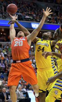 Marquette forward Davante Gardner (54) fouls Syracuse guard Brandon Triche (20) in the first half of the NCAA Tournament East Regional final at the Verizon Center in Washington, D.C., Saturday, March 30, 2013. (Harry E. Walker/MCT) Photo: Harry E. Walker, McClatchy-Tribune News Service / Harry E. Walker, Copyright 2012
