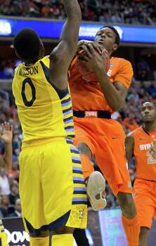 Syracuse forward Jerami Grant (3) secures a rebound against Marquette forward Jamil Wilson (0) in the first half of the NCAA Tournament East Regional final at the Verizon Center in Washington, D.C., Saturday, March 30, 2013. (Harry E. Walker/MCT) Photo: Harry E. Walker, McClatchy-Tribune News Service / Harry E. Walker, Copyright 2012