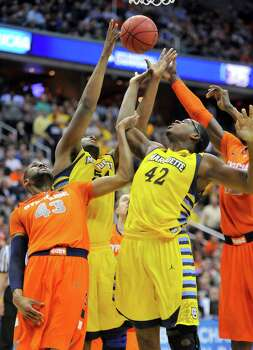 Marquette forward Davante Gardner (54) and Marquette center Chris Otule (42) battle for a rebound against Syracuse forward James Southerland (43) in the first half of the NCAA Tournament East Regional final at the Verizon Center in Washington, D.C., Saturday, March 30, 2013. (Mark Gail/MCT) Photo: Mark Gail, McClatchy-Tribune News Service / MCT