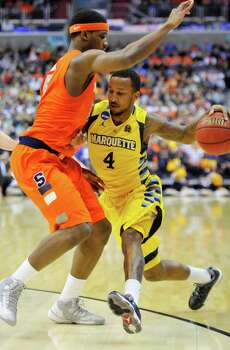 Marquette guard Todd Mayo (4) attempts to drive past Syracuse forward C.J. Fair (5) in the first half of the NCAA Tournament East Regional final at the Verizon Center in Washington, D.C., Saturday, March 30, 2013. (Mark Gail/MCT) Photo: Mark Gail, McClatchy-Tribune News Service / MCT