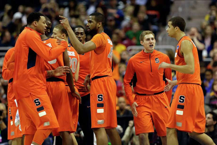 WASHINGTON, DC - MARCH 30:  Syracuse Orange reacts after a timeout by Marquette Golden Eagles during the East Regional Round Final of the 2013 NCAA Men's Basketball Tournament at Verizon Center on March 30, 2013 in Washington, DC. Photo: Win McNamee, Getty Images / 2013 Getty Images