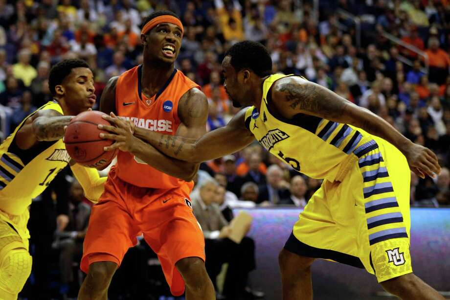 WASHINGTON, DC - MARCH 30:  C.J. Fair #5 of the Syracuse Orange handles the ball against Junior Cadougan #5 and Vander Blue #13 of the Marquette Golden Eagles during the East Regional Round Final of the 2013 NCAA Men's Basketball Tournament at Verizon Center on March 30, 2013 in Washington, DC. Photo: Win McNamee, Getty Images / 2013 Getty Images
