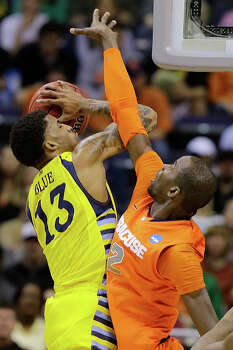 Syracuse center Baye Keita (12) defends against Marquette guard Vander Blue (13) during the first half of the East Regional final in the NCAA men's college basketball tournament, Saturday, March 30, 2013, in Washington. (AP Photo/Alex Brandon) Photo: Alex Brandon, Associated Press / AP