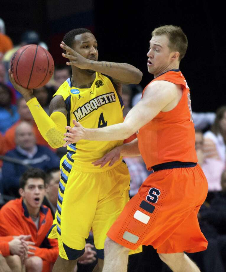 Syracuse guard Trevor Cooney (10), right, defends Marquette guard Todd Mayo (4) in the first half of the NCAA Tournament East Regional final at the Verizon Center in Washington, D.C., Saturday, March 30, 2013. (Harry E. Walker/MCT) Photo: Harry E. Walker, McClatchy-Tribune News Service / Harry E. Walker, Copyright 2012