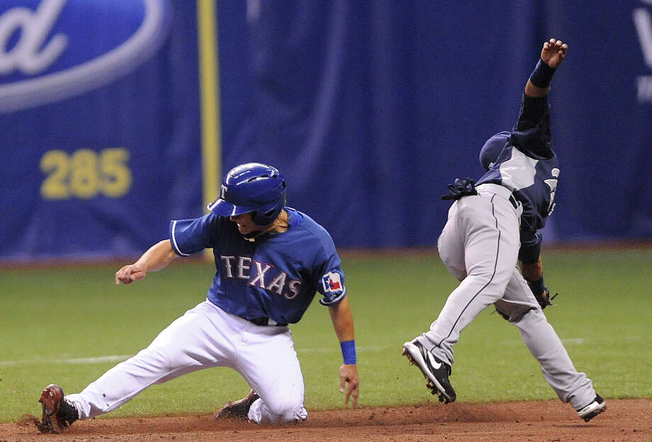 Greg Miclat of the Texas Rangers slides safely into second as Alexi Amarista of the San Diego Padres awaits the throw during Big League Weekend exhibition baseball action at the Alamodome on Saturday, March 30, 2013. Photo: Billy Calzada, Express-News / San Antonio Express-News