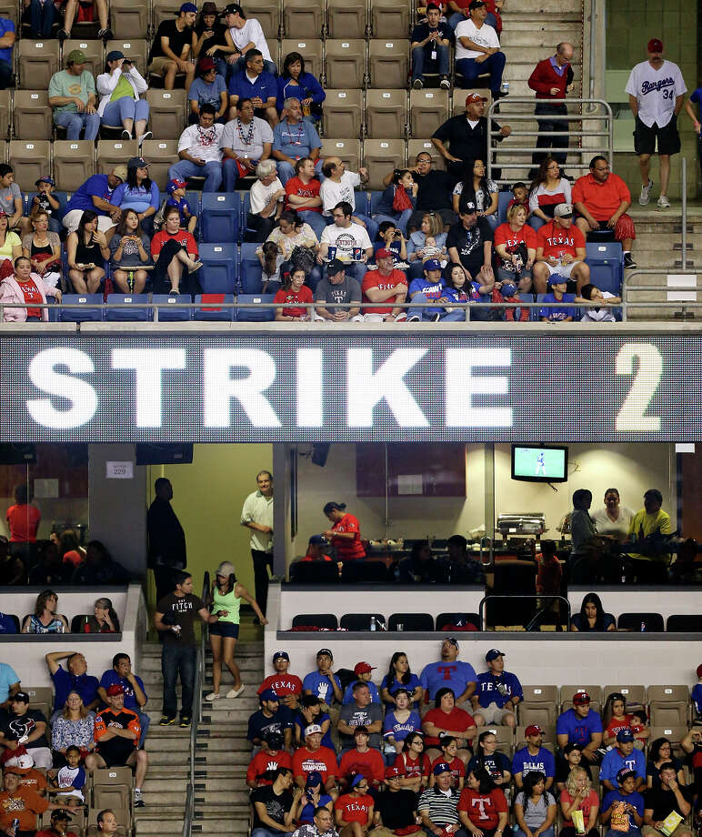 Fans watch the Texas Rangers and San Diego Padres  exhibition baseball game part of the �Big League Weekend� Saturday March 30, 2013 at the Alamodome. The Rangers won 5-2. Photo: Edward A. Ornelas, Express-News / © 2013 San Antonio Express-News