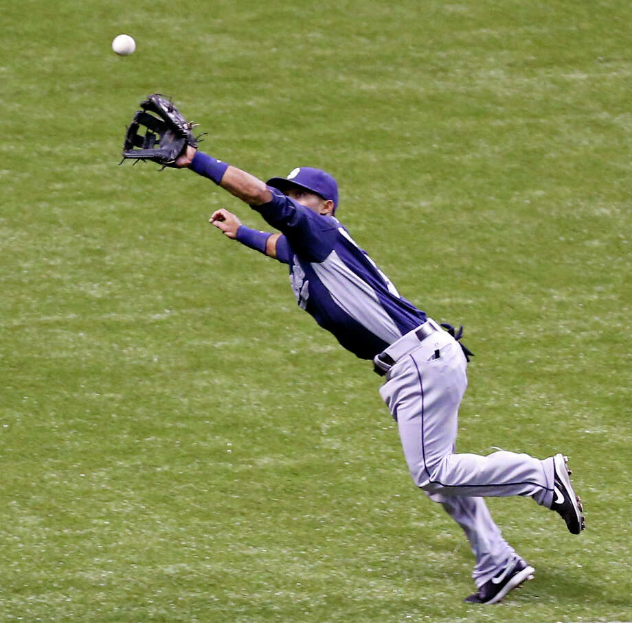San Diego Padres' Alexi Amarista catches a line drive hit by Texas Rangers' Jurickson Profar during the fifth inning of an exhibition baseball game part of the �Big League Weekend� Saturday March 30, 2013 at the Alamodome. The Rangers won 5-2. Photo: Edward A. Ornelas, Express-News / © 2013 San Antonio Express-News