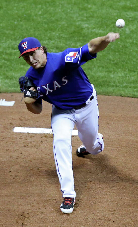 Texas Rangers' Derek Holland pitches against the San Diego Padres during an exhibition baseball game part of the �Big League Weekend� Saturday March 30, 2013 at the Alamodome. The Rangers won 5-2. Photo: Edward A. Ornelas, Express-News / © 2013 San Antonio Express-News