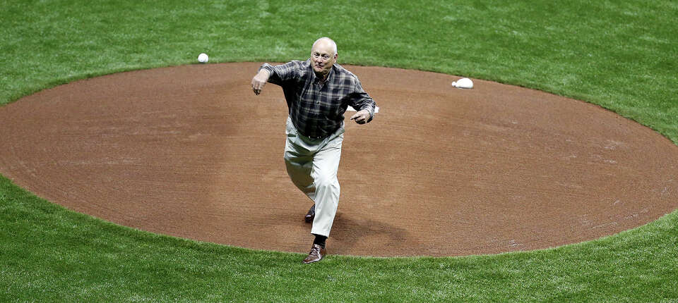 Texas Rangers' CEO Nolan Ryan throws out the first pitch before the game with the San Diego Padres p