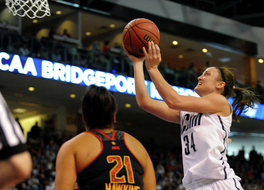 UConn's Kelly Faris goes to the hoop for two, during the women's NCAA Tournament Regional Semifinal action against University of Maryland at the Webster Bank Arena in Bridgeport, Conn. on Saturday March 30, 2013. Photo: Christian Abraham / Connecticut Post