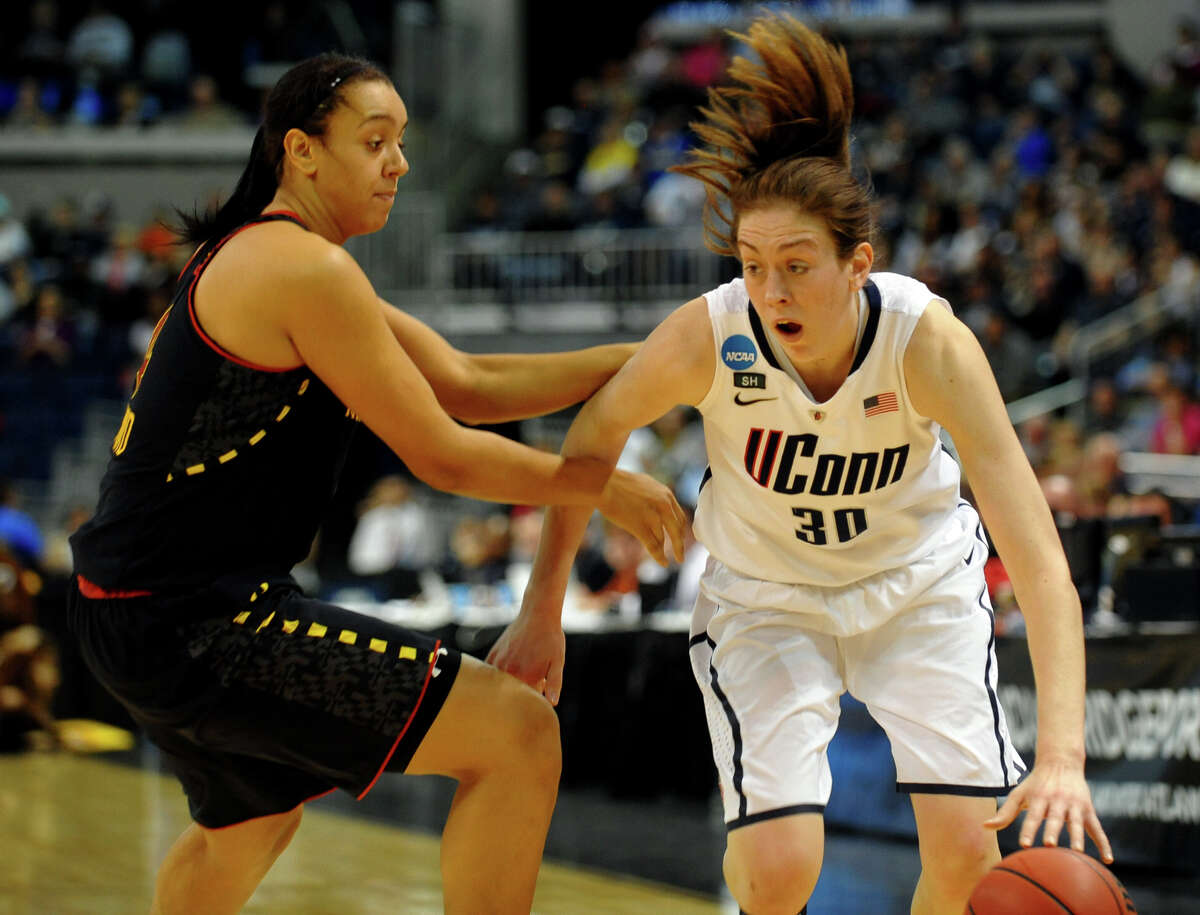 UConn's Breanna Stewart tries to gel around University of Maryland's Malina Howard, during the women's NCAA Tournament Regional Semifinals at the Webster Bank Arena in Bridgeport, Conn. on Saturday March 30, 2013.