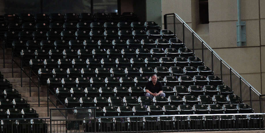 The lone man sits in a section of the stands as the Houston Astros play the Chicago Cubs during the fifth inning of MLB exhibition game at Minute Maid Park Saturday, March 30, 2013, in Houston . Photo: James Nielsen, Houston Chronicle / © 2013 Houston Chronicle