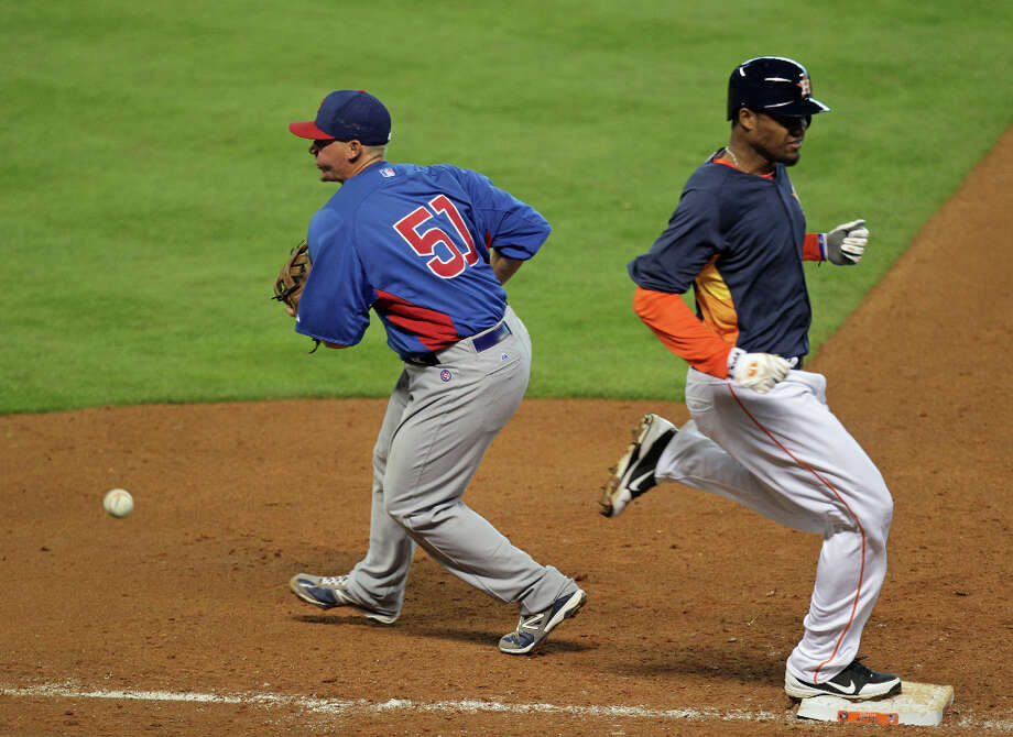 The Houston Astros Domingo Santana right, beats out the Chicago Cubs Steve Clevenger left, to first base during the fifth inning of MLB exhibition game action at Minute Maid Park Saturday, March 30, 2013, in Houston . Photo: James Nielsen, Houston Chronicle / © 2013 Houston Chronicle
