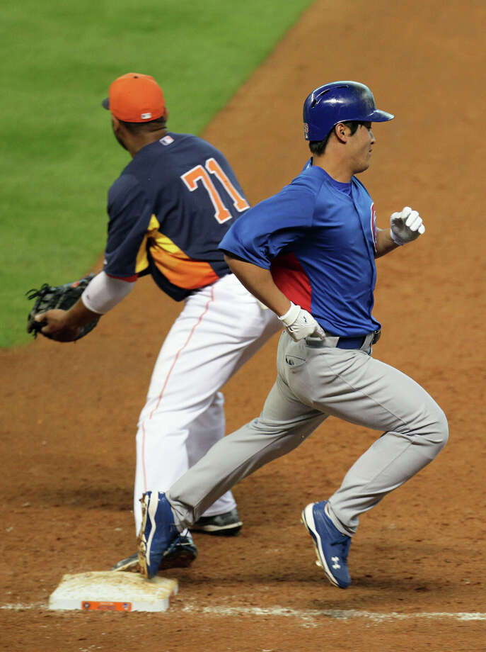 The Houston Astros Jonathan Singleton left, tags the base to put out the Chicago Cubs Jae-Hoon Ha during the fifth inning of MLB exhibition game action at Minute Maid Park Saturday, March 30, 2013, in Houston . Photo: James Nielsen, Houston Chronicle / © 2013 Houston Chronicle