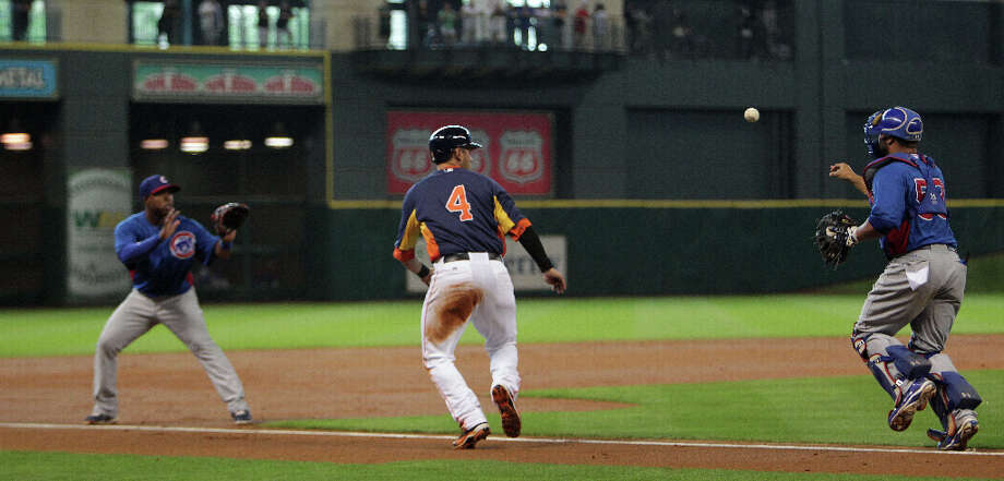 The Chicago Cubs third baseman Luis Valbuena left, and Chicago Cubs catcher Wellington Castillo right, chase down the Houston Astros Brandon Laird for an out during the second inning of MLB exhibition game action at Minute Maid Park Saturday, March 30, 2013, in Houston . Photo: James Nielsen, Houston Chronicle / © 2013 Houston Chronicle