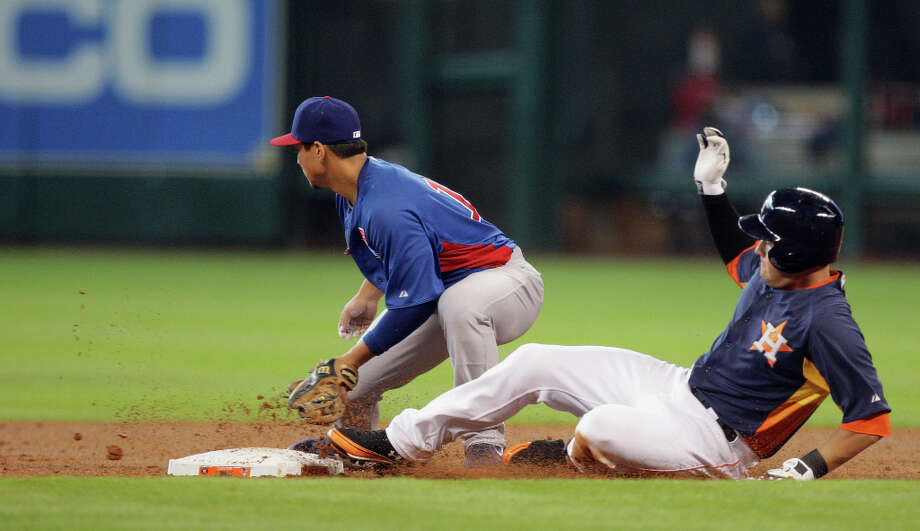 The Houston Astros Brandon Laird right, slides into second base after hitting a double as the Chicago Cubs second baseman Darwin Barney fields the ball during the second inning of MLB exhibition game action at Minute Maid Park Saturday, March 30, 2013, in Houston . Photo: James Nielsen, Houston Chronicle / © 2013 Houston Chronicle