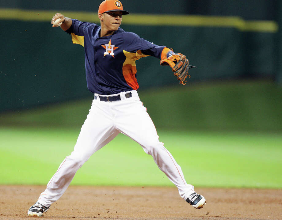 The Houston Astros Carlos Correa throws the ball to first base during the second inning of MLB exhibition game action Chicago Cubs at Minute Maid Park Saturday, March 30, 2013, in Houston . Photo: James Nielsen, Houston Chronicle / © 2013 Houston Chronicle