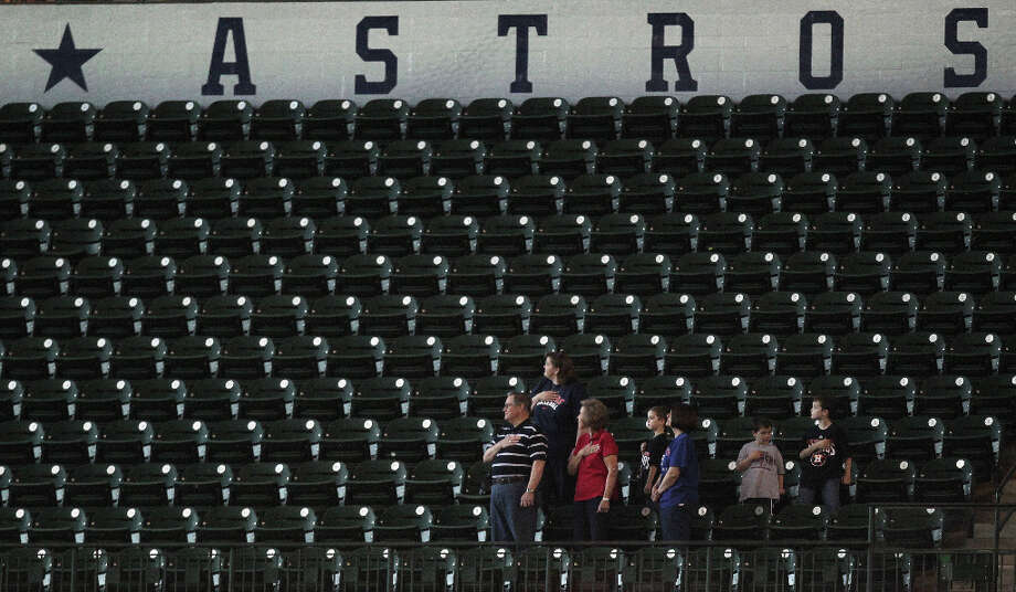 Fans stand during the National Anthem prior to the MLB exhibition game between the Chicago Cubs and the Houston Astros at Minute Maid Park Saturday, March 30, 2013, in Houston . Photo: James Nielsen, Houston Chronicle / © 2013 Houston Chronicle