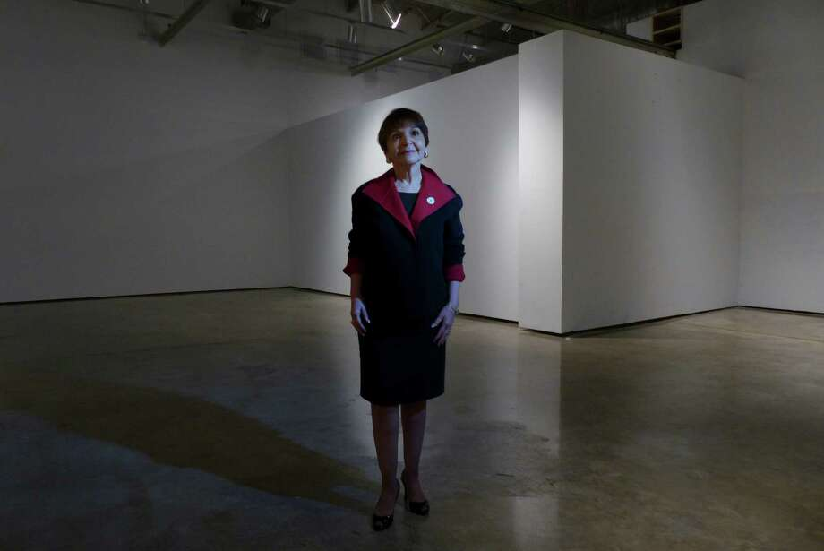 "Texas A&M-San Antonio President Maria Hernandez Ferrier says the hot-pink facade of the old Museo Alameda will remain. ""Frankly, I love the pink, because it is very Mexicano; it is very San Antonio. I think it's beautiful, myself,"" she explains. Photo: Billy Calzada, San Antonio Express-News / San Antonio Express-News"