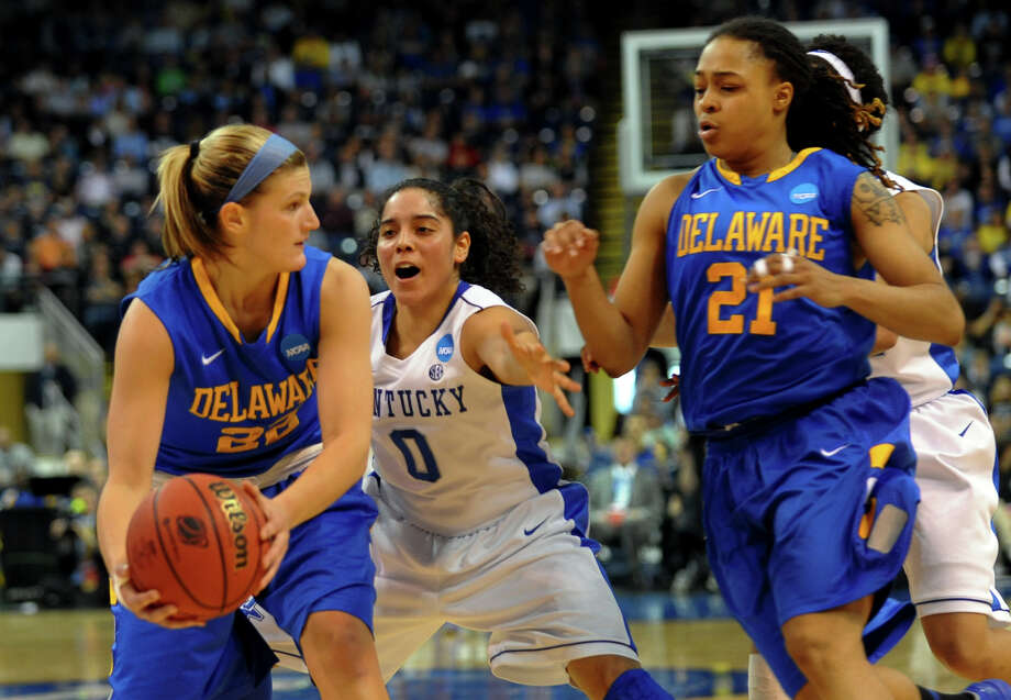 University of Kentucky's Jennifer O'Neill looks to break up a pass by University of Delaware's Lauren Carra, left, during women's NCAA Tournament Regional Semifinal action at the Webster Bank Arena in Bridgeport, Conn. on Saturday March 30, 2013. Photo: Christian Abraham / Connecticut Post