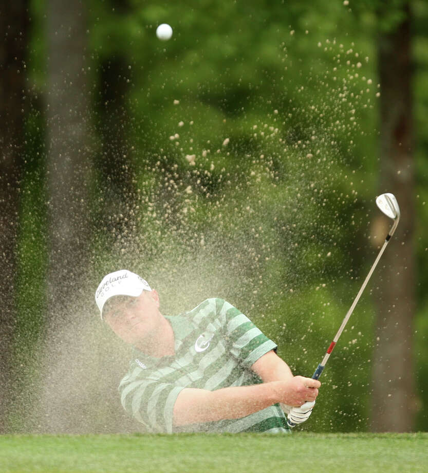 Steve Kokrak blast from a green-side bunker on No. 9 during the third round of the Shell Houston Open, Saturday, March 30, 2013 at the Redstone Tournament Course in Humble. (Photo: Eric Christian Smith/For the Houston Chronicle) Photo: Eric Christian Smith, For The Chronicle