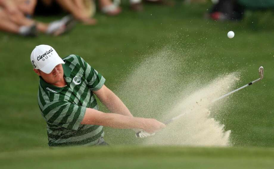Jason Kokrak hits his third shot from a green-side bunker on No. 18 during the third round of the Shell Houston Open, Saturday, March 30, 2013 at the Redstone Tournament Course in Humble. (Photo: Eric Christian Smith/For the Houston Chronicle) Photo: Eric Christian Smith, For The Chronicle