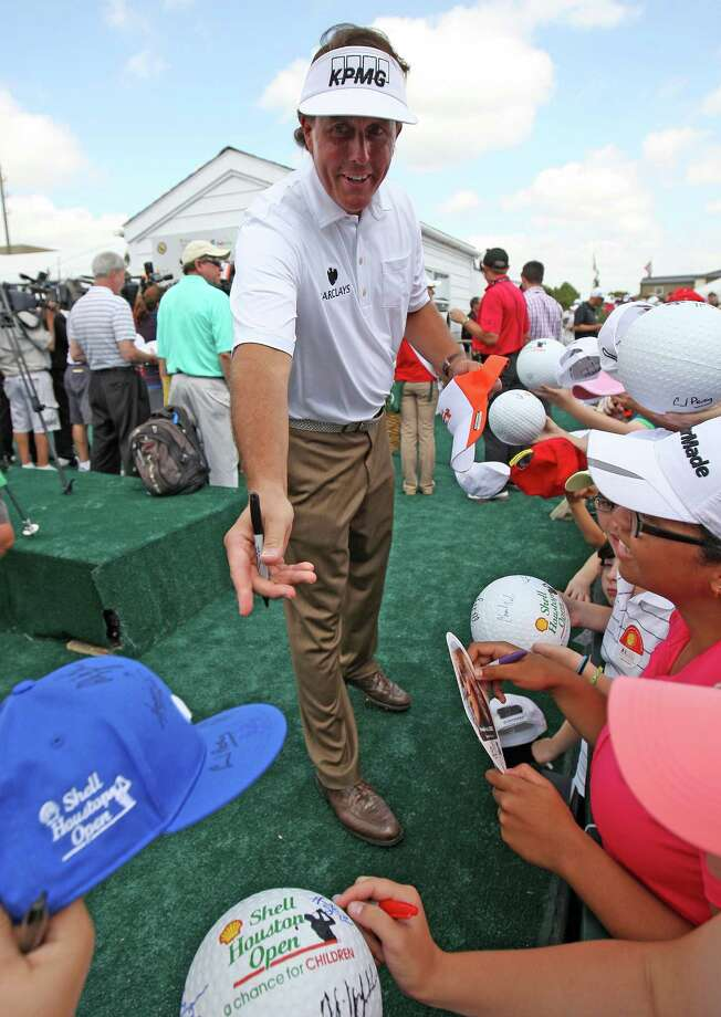 Phil Mickelson signs autographs after his 5-under par performance during the third round of the Shell Houston Open, Saturday, March 30, 2013 at the Redstone Tournament Course in Humble. (Photo: Eric Christian Smith/For the Houston Chronicle) Photo: Eric Christian Smith, For The Chronicle