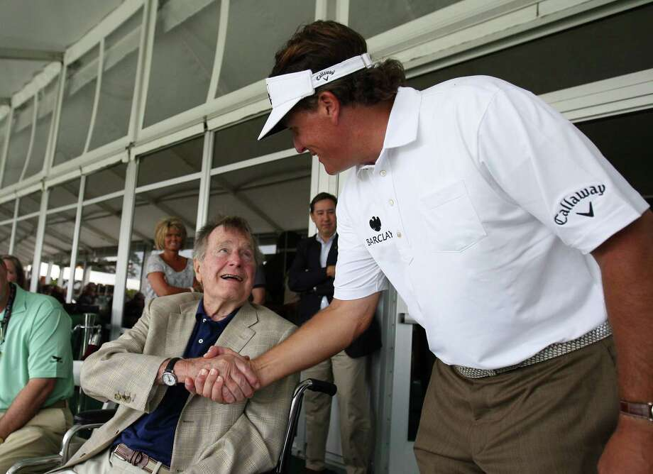 Phil Mickelson (right) shakes the hand of President George H.W. Bush during the third round of the Shell Houston Open, Saturday, March 30, 2013 at the Redstone Tournament Course in Humble. (Photo: Eric Christian Smith/For the Houston Chronicle) Photo: Eric Christian Smith, For The Chronicle