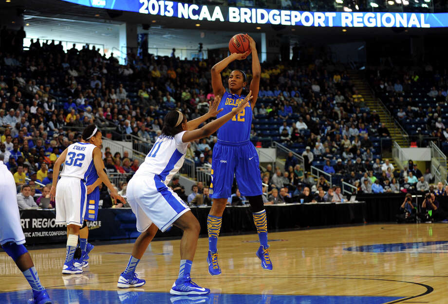 University of Delaware's Danielle Parker looks for two as University of Kentucky's DeNasha Stallworth defends, during the women's NCAA Tournament Regional Semifinals at the Webster Bank Arena in Bridgeport, Conn. on Saturday March 30, 2013. Photo: Christian Abraham / Connecticut Post