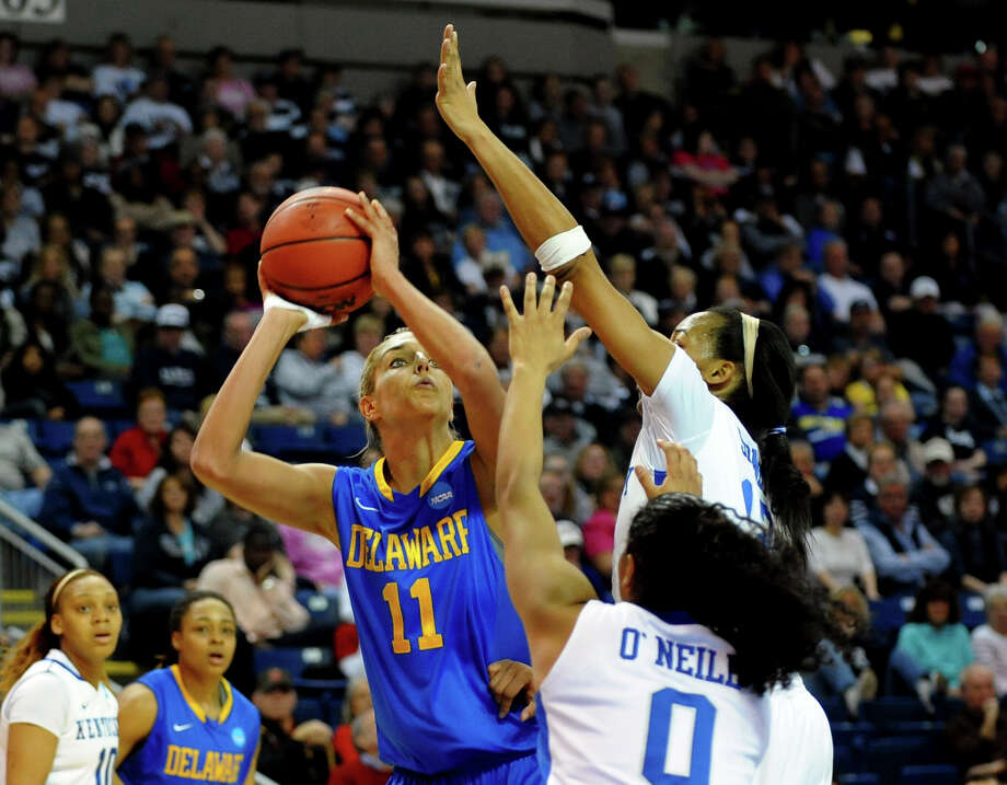 University of Delaware's Elena Delle Donne attempts a basket as she is blocked by University of Kentucky's Jelleah Sidney, during the women's NCAA Tournament Regional Semifinals at the Webster Bank Arena in Bridgeport, Conn. on Saturday March 30, 2013. Photo: Christian Abraham / Connecticut Post