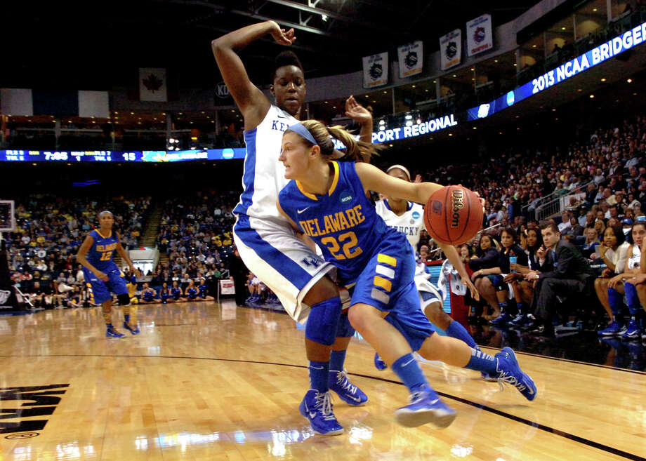 University of Delaware's Lauren Carra drives to the basket as University of Kentucky's Samarie Walker defends, during the women's NCAA Tournament Regional Semifinals at the Webster Bank Arena in Bridgeport, Conn. on Saturday March 30, 2013. Photo: Christian Abraham / Connecticut Post