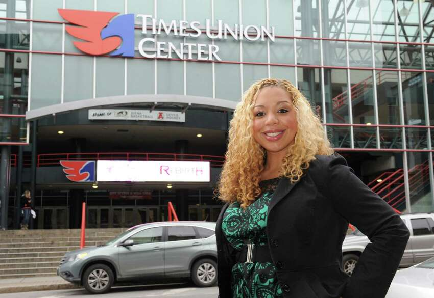 Starr Williams stands in front of the Times Union Center on Monday, March 25, 2013 in Albany, N.Y. Williams is upset about how Times Union Center security handled an incident of racial slurs directed at her from people in the row behind her during a Kenny Chesney concert. (Lori Van Buren / Times Union)