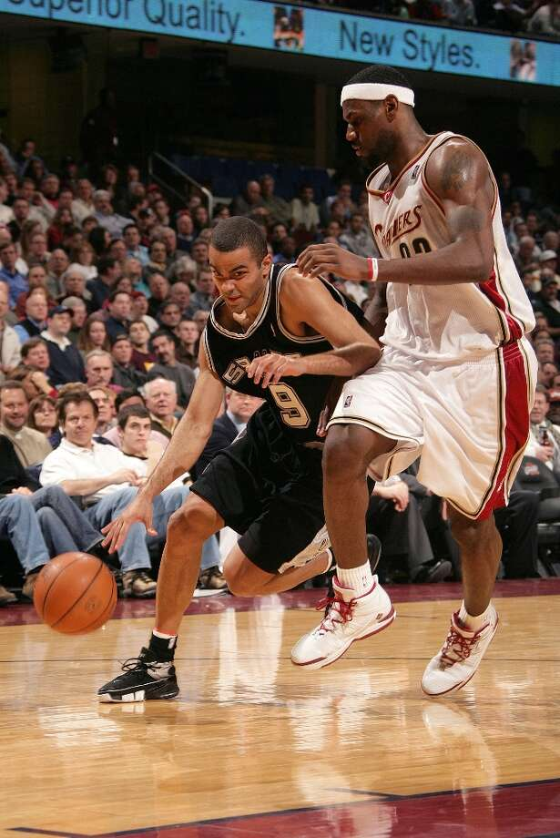 The Spurs' Tony Parker (9) drives inside on the Cavaliers' LeBron James on Feb. 13, 2006 in Cleveland. The Cavaliers won 101-87. Photo: David Liam Kyle, NBAE/Getty Images / 2006 NBAE