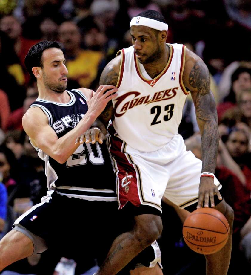 The Cavaliers' LeBron James (23) tries to get past the Spurs' Manu Ginobili (20) on April 5, 2009, in Cleveland. The Cavaliers won 101-81. Photo: Tony Dejak, AP / AP