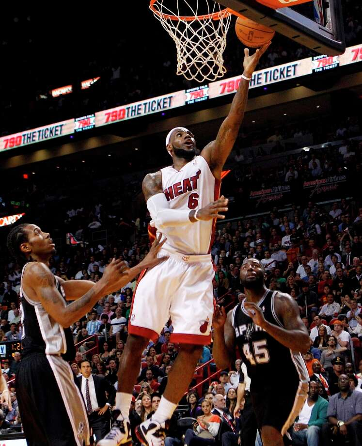 The Heat's LeBron James (6) shoots over the Spurs' Kawhi Leonard (2) and DeJuan Blair (45) on Jan. 17, 2012, in Miami. The Heat won 120-98. Photo: Lynne Sladky, AP / AP