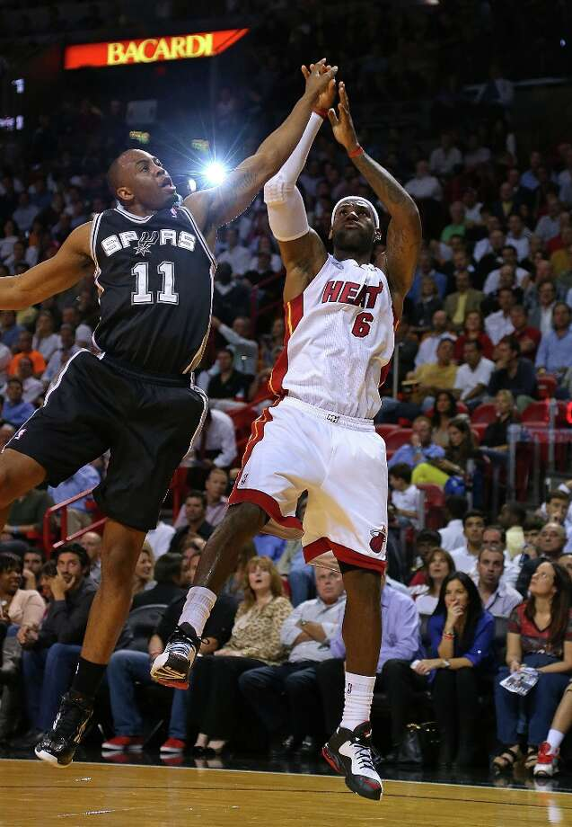 LeBron James (6) of the Heat shoots over James Anderson (11) of the Spurs at American Airlines Arena on Nov. 29, 2012 in Miami.  The Heat won 105-100 when the Spurs sent several key players home before the game. Photo: Mike Ehrmann, Getty Images / 2012 Getty Images