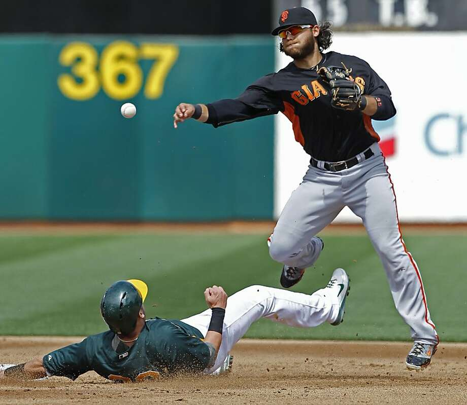 Shortstop Brandon Crawford retires Josh Donaldson and fires to first on a double-play ball in the second. Photo: Michael Macor, The Chronicle