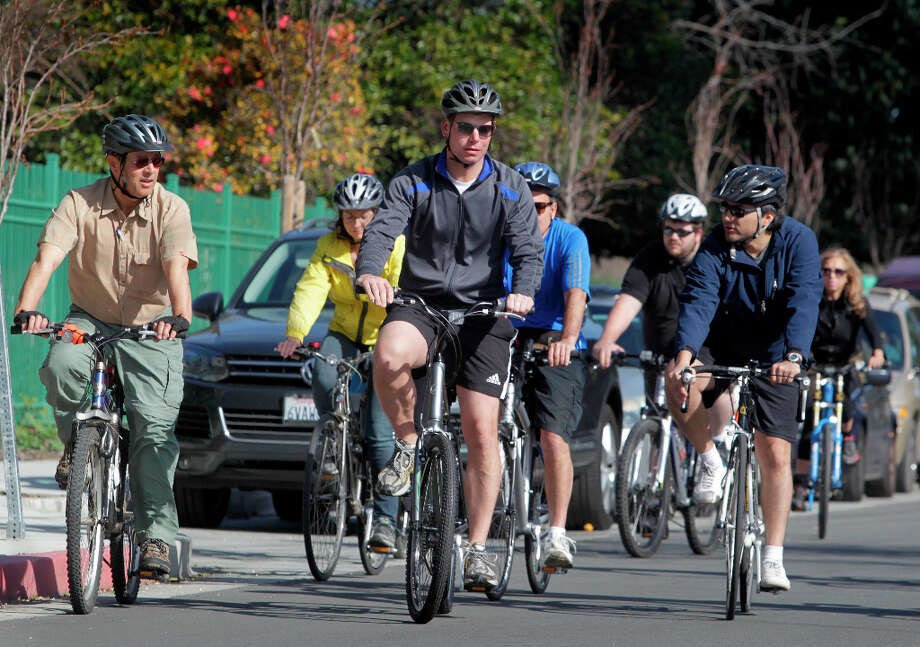 Freshman congressman Rep. Eric Swalwell (center) guides constituents on a six-mile bike ride in Hayward on March 23. Photo: Paul Chinn, The Chronicle / ONLINE_YES