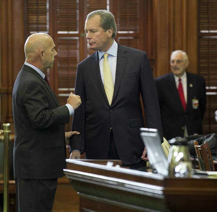 Lt. Gov. David Dewhurst (right) talks with Sen. John Whitmire on the Senate floor at the Capitol. Photo: Deborah Cannon /